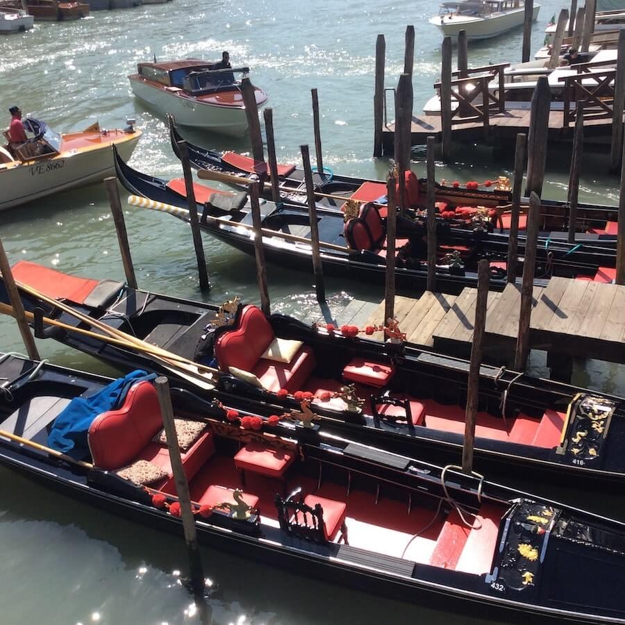 venice gondola boats in row