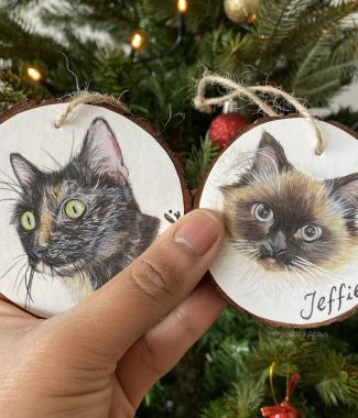 cat portrait christmas ornament held in hand