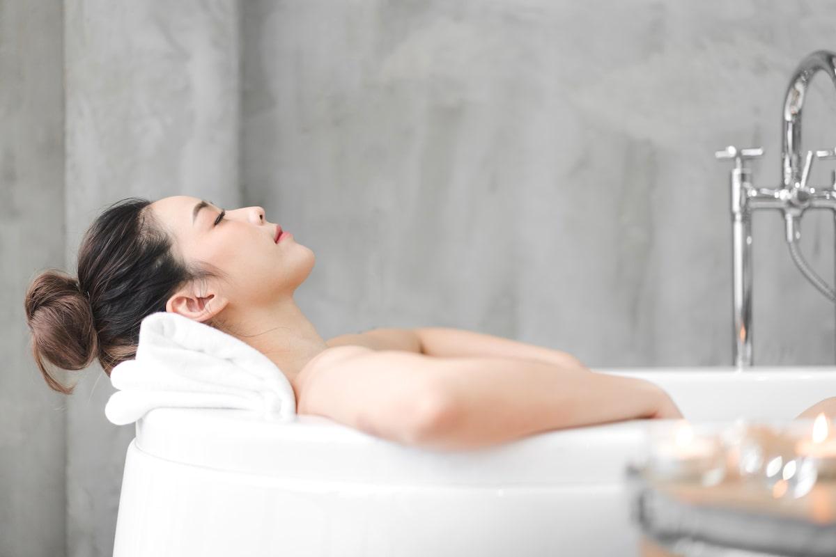 Woman relaxing taking a bath
